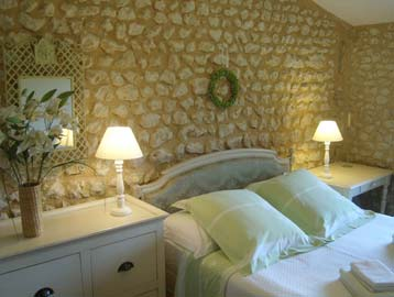 furniture and white cotton bedlinen are typical in French interiors